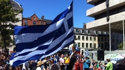 Members of the Greek community gathered alongside anti-austerity protesters outside the Central Bank