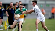 Offaly's Graham Guilfoyle with Eoin Doyle of Kildare