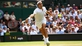 Federer and Murray advance in four sets at SW19