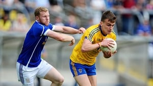 Roscommon's Enda Smith with Rory Dunne of Cavan