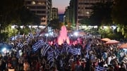 Supporters of 'No' wave flags and react after the first results of the referendum at Syntagma Square, in Athens