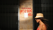A sign outside the Bank of Greece is defaced with graffiti to read 'Banque de Merkel'