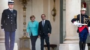 Angela Merkel and Francois Hollande have requested an emergency meeting of euro zone leaders in Brussels