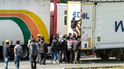 Migrants have been seen trying to climb onto trucks queuing in Calais
