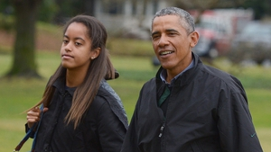 Malia and Barack Obama returning from a family vacation in Hawaii