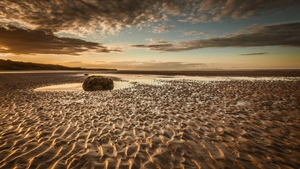 """After water and air, sand is the most widely used resource on earth."" Photo: Gormanstown beach at sunset by Tony Mullen"
