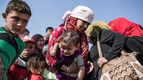 Syrian refugees cross the Syria-Turkey border last month