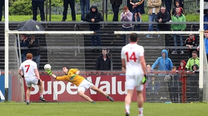 Tyrone's Peter Harte scores from the penalty spot