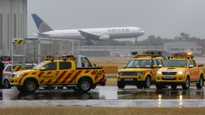 Emergency services parked on the northern runaway at Heathrow Airport during a protest