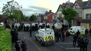 A number of people were injured after loyalists rioted in Belfast when a contentious Orange Order parade was halted in July