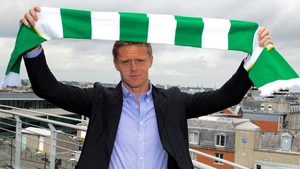 Damien Duff poses with the Shamrock Rovers colours after signing for the Tallaght club