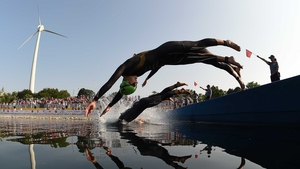 Claudia Rivas of Mexico dives into the water at the start of the women's triathlon at Ontario Place during the during the 2015 Pan American Games