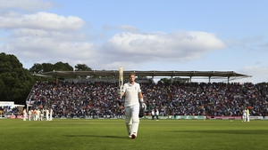 Joe Root of England raises his bat as he leaves the field after being dismissed for 134 runs by Mitchell Starc of Australia during day one of the 1st Investec Ashes Test match between England and Australia