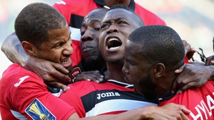 Sheldon Bateau of Trinidad & Tobago (centre) celebrates a first half goal against Guatemala with his team-mates including Radanfah Abu Bakr (left) and Khaleem Hyland (right) during a match in the 2015 CONCACAF Gold Cup at Soldier Field, Chicago