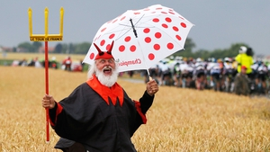 Dieter 'Didi' Senft, the self-styled 'Devil' of the Tour de France, cheers on the riders during stage five - a 189.5km stage between Arras and Amiens
