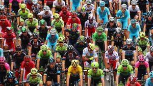 The peloton rides at the start of stage four of the 2015 Tour de France - a 223.5km stage between Seraing and Cambrai