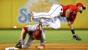 AJ Pollock of the Arizona Diamondbacks slides safely to second base before the tag of Rougned Odor of the Texas Rangers in the sixth innings during a game at Globe Life Park in Arlington, Texas
