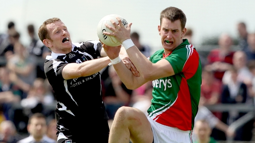 Sligo's Mark Breheny and Barry Moran of Mayo in action during the 2012 Connacht final between the sides