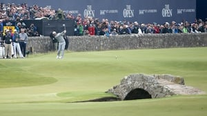 Dustin Johnson teeing off on the 18th hole