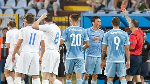 Slovan Bratislava's Nicolas Gorosito sees red for his horror tackle on Robbie Benson
