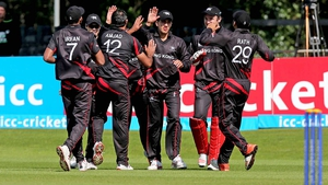 Hong Kong players celebrate taking the wicket of Ireland's Andrew Balbrine