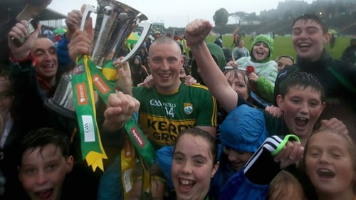 Kerry captain Kieran Donaghy celebrates with supporters at the end of the game
