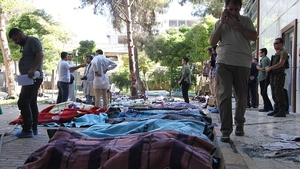 Bodies were covered with blankets at the site of the explosion