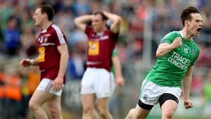 Tomás Corrigan turns away in delight after firing over another point at Breffni Park