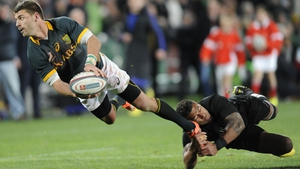 South Africa's Willie le Roux is tackled by Charles Piutau of New Zealand