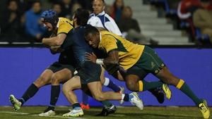 Dean Mumm crashes over the whitewash for Australia's second try at Estadio Malvinas Argentinas