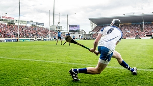 Waterford's Austin Gleeson attempts a side line puck against Dublin