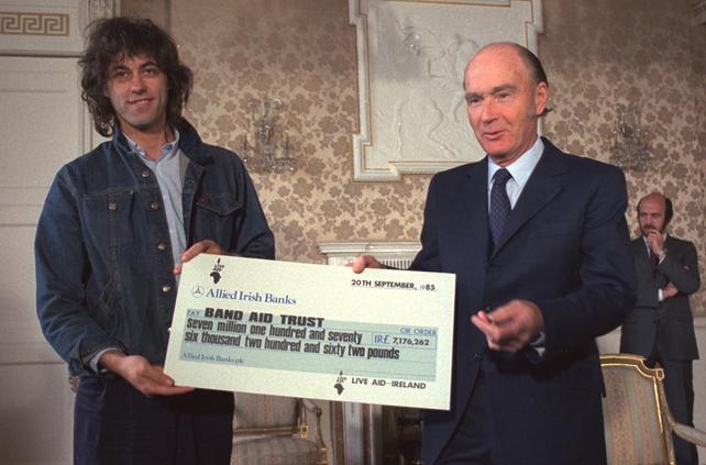 Bob Geldof Receives Cheque from President Hillery (1985)