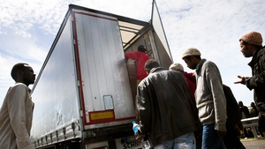 Migrants regularly try to board trucks travelling by the rail tunnel to Britain