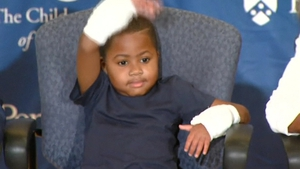 Zion Harvey had his hands amputated when he was two after a serious infection