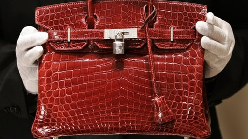 Hermes, known for its $10,000-plus hand-stitched Birkin and Kelly bags, said revenue rose 11%