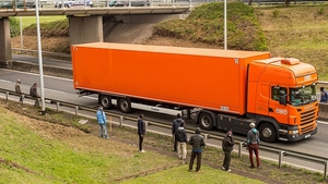 Migrants stand along the A16 highway as they try to access the Channel Tunnel