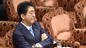 There is no specific mention of wiretapping Shinzo Abe