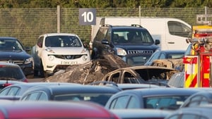 The plane crashed into a car auction site and burst into flames