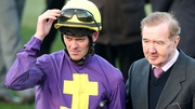 Robbie McNamara pictured with trainer Dermot Weld last year