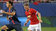 Bastian Schweinsteiger tracks Zlatan Ibrahimovic of PSG during a friendly in Chicago