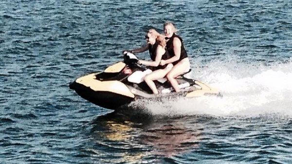 Amy Schumer and Jennifer Lawrence jet skiing, image via Amy Schumer/Instagram