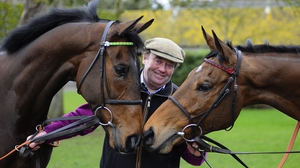 Nicky Henderson pictured with My Tent Or Yours (L) and Bobs Worth last year