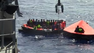Migrants are rescued by LÉ Niamh crew members (Pic: Irish Defence Forces)