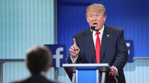 Donald Trump drew boos from the audience but only one contender directly challenged him