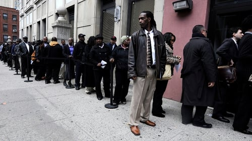 The US economy added 215,000 jobs last month, down from an upwardly revised 231,000 in June