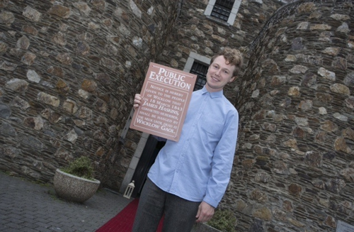 Dylan with the notice of James Haskins' execution at Wicklow Gaol