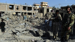 Afghan security force and residents inspect damage houses near of a powerful truck bomb in Kabul