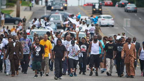 Marchers shouted slogans such as 'Hands up, don't shoot' and 'We do this for who? We do this for Mike Brown.'