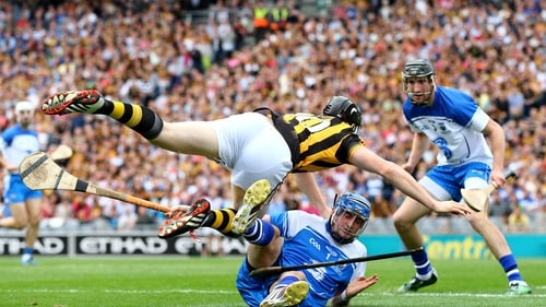 Waterford goalkeeper Stephen O'Keeffe tangles with Walter Walsh of Kilkenny