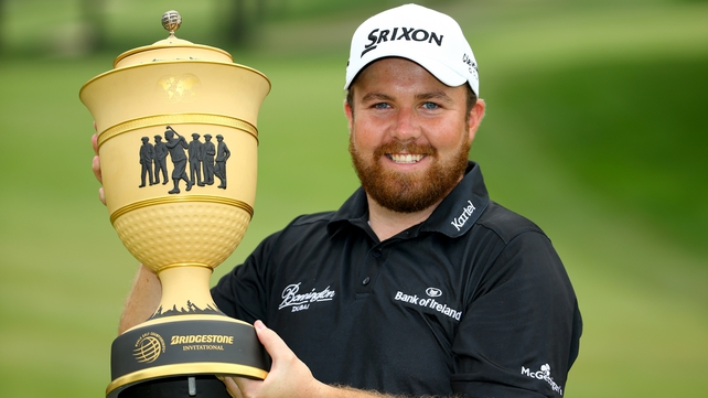Shane Lowry holds WGC-Bridgestone trophy